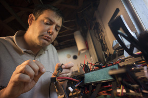Parker Gyokeres of Propellerheads Aerial Photography soldering the electronics on a new multicopter.